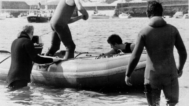 Police frogmen at the scene of the murders of Lord Mountbatten and others in 1979