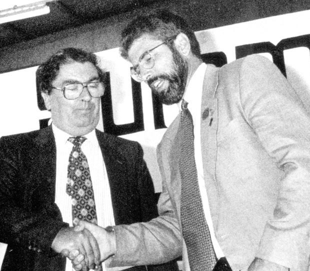 John Hume shake hands with Gerry Adams