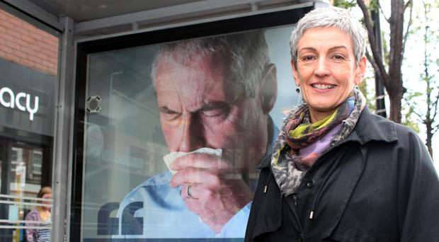 Dr Miriam McCarthy, Consultant at the Public Health Agency (PHA), at one of the PHA's 'coughing' bus shelters in Belfast