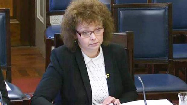 Caral Ni Chuilin answers questions at a Stormont committee session
