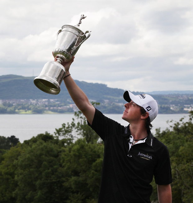 Rory McIlroy displays the US Open trophy, his first Major, in his native Holywood four years ago