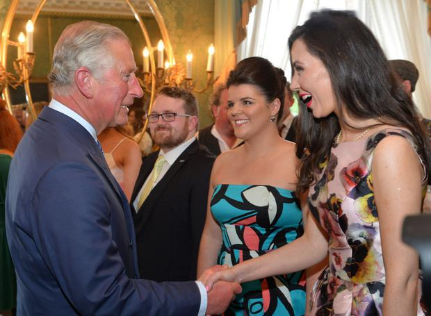 Prince Charles meets singers who took part in the evening of music, song and word at Hillsborough Castle