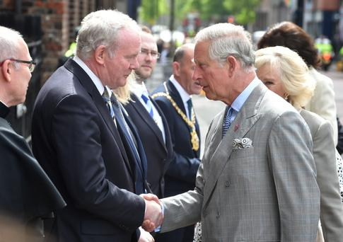 Prince Charles and Martin McGuinness shake hands during the Royal visit to St Patrick's Church yesterday