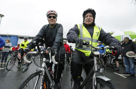 Cycling companions Peter Robinson and Sammy Douglas taking part in a charity cycle ride in support of organ donation in 2012