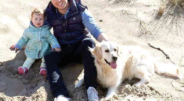 Andy Harper with daughter Sophia and golden retriever Finn