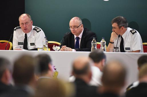 From left: Chief Constable George Hamilton, PFNI chairman Mark Lindsay and ACC Drew Harris address delegates during the conference