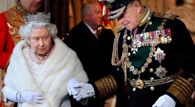 The Queen, accompanied by Prince Philip, leaves the Palace of Westminster after the State Opening of Parliament yesterday