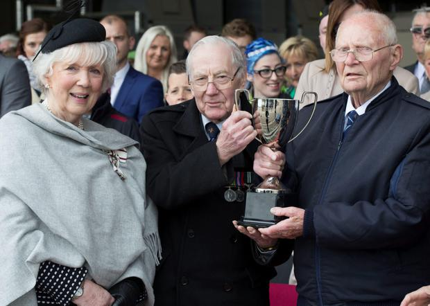 Dickie Spencer (left) and Bill Eames receive the Northern Ireland Aircrew Cup from the Lord Lieutenant of County Antrim, Joan Christie, for their quest to recover 502 Squadron's scattered silverware