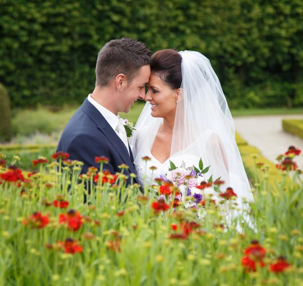 Stewart and Alex Brown on their wedding day in the grounds of Antrim Castle