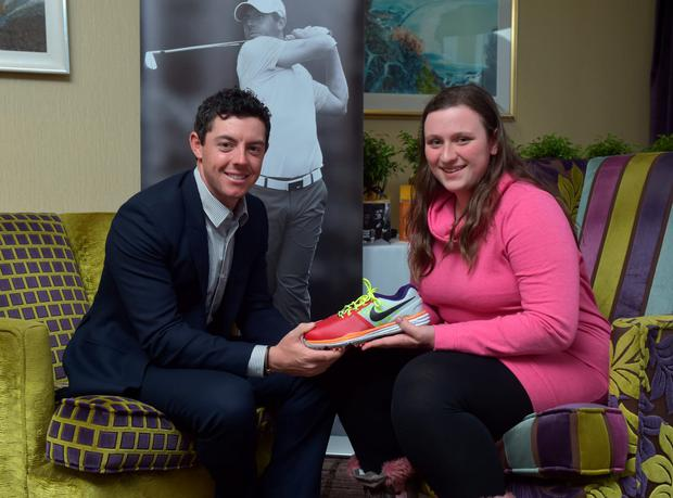Sara Lockhart, who designed Rory's Nike golf shoes for the opening round, meets her hero yesterday CHARLES MCQUILLAN