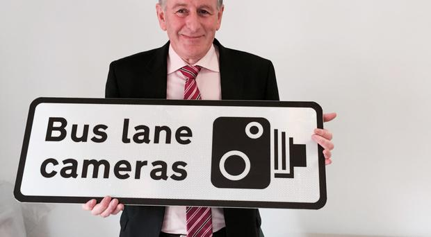 Ciaran de Burca, director of transport projects at the DRD, with one of the signs which will warn motorists over driving in bus lanes in Belfast
