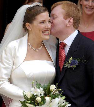 Kennedy on his wedding day kissing his bride Sarah Gurling in 2002