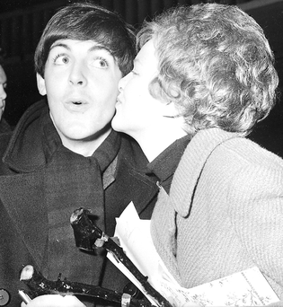 Paul McCartney gets a kiss from a fan