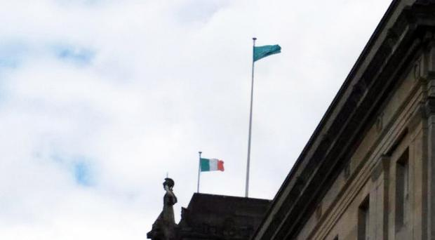 The Irish tricolour on a flagpole over Parliament Buildings at Stormont yesterday
