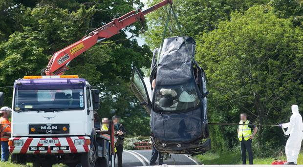 The remains of the Volkswagen Golf are removed from the crash scene