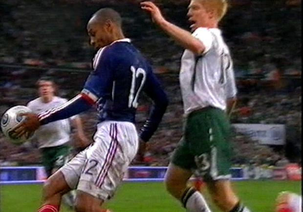 Thierry Henry of France handles the ball as he sets up the goal to end the Republic's hopes of qualifying for the 2010 World Cup