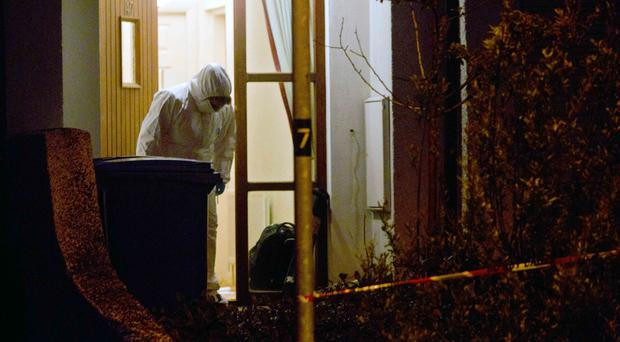 Forensic officers at scene where two bodies were found the Abbey area of Ballycastle
