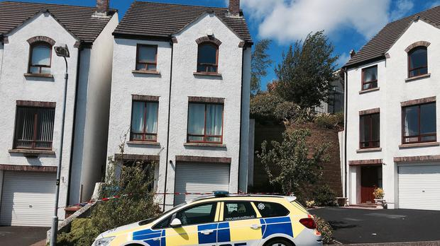 Police at the scene in the Abbey area of Ballycastle, Co Antrim