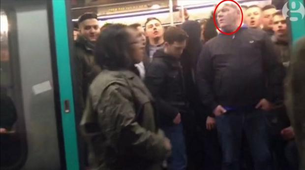 Richard Barklie (circled) aboard the Paris train on which Chelsea fans subjected a man to racist abuse