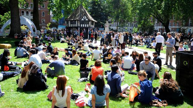 People enjoy the sunny weather in London