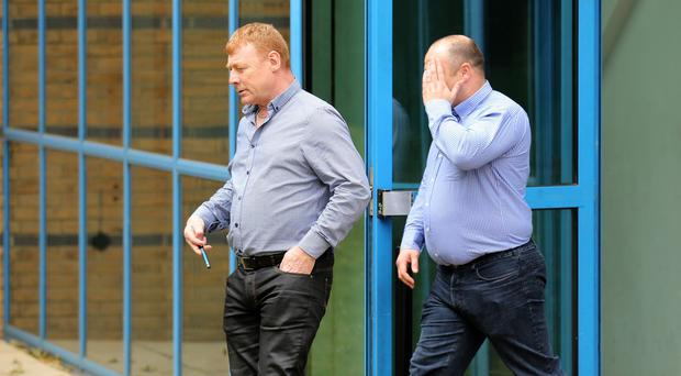 Martin McGlinchey, left, and Stephen McLaughlin leave Basildon Crown Court in Essex where they and two other men denied their involvement in a people-smuggling operation
