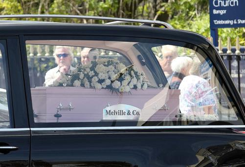 The tiny coffin at the funeral of five-year-old Katie Bogle yesterday