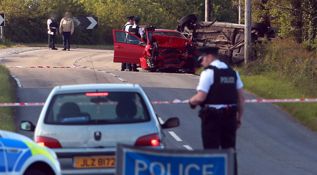 Police at the scene of the crash on the Manoo Road in Kesh on Wednesday in which businessman John Forsythe died