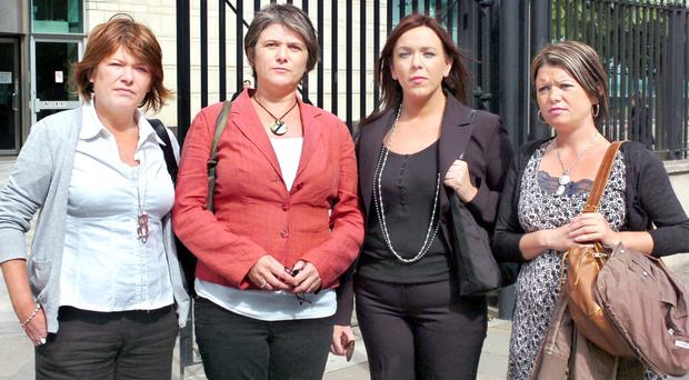 Robert McCartney's sisters (from left) Paula, Catherine and Claire (far right) and his partner Briege (second from right)