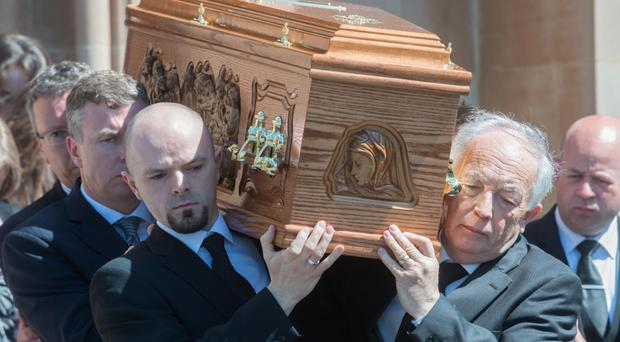 Jim McCauley (far right) carries the coffin of his son Paul at his funeral at St Columb's Church, Derry