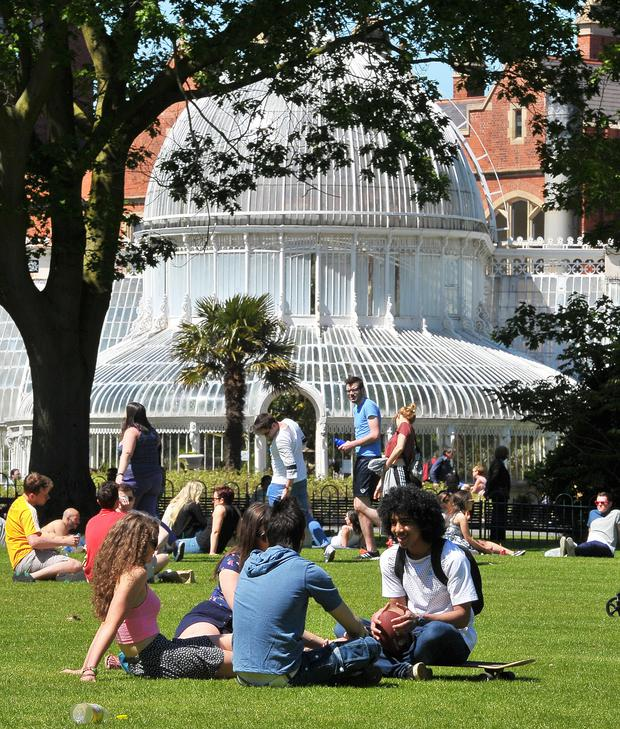 Sunseekers in the grounds of Botanic Gardens in Belfast