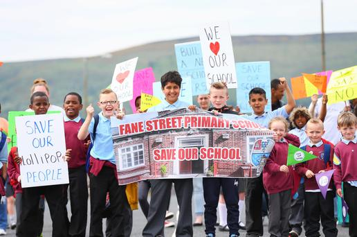 Kids rom Fane Street Primary School in south Belfast block the Donegall Road yesterday in protest at its potential closure