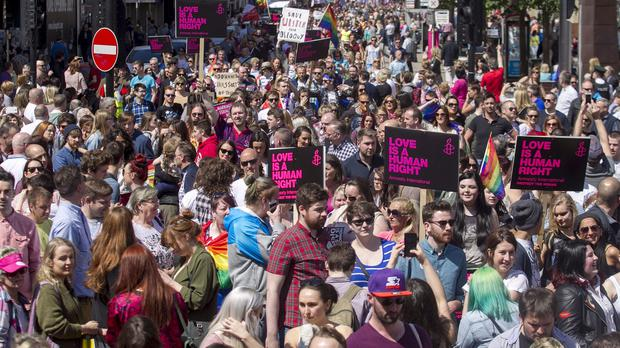 Campaigners attend a rally in Belfast to show their support for gay marriage