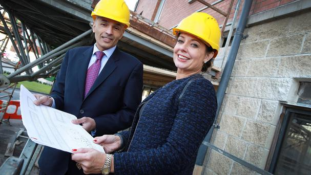 Andras Hotels director Rajesh Rana and interior designer Janine Powell look at construction plans as the Days Hotel in Belfast is to undergo a £2.5 million upgrade