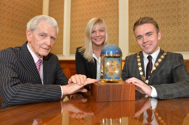 Clock owner Jim Fitzpatrick with Deputy Lord Mayor Guy Spence and city council chief Suzanne Wylie