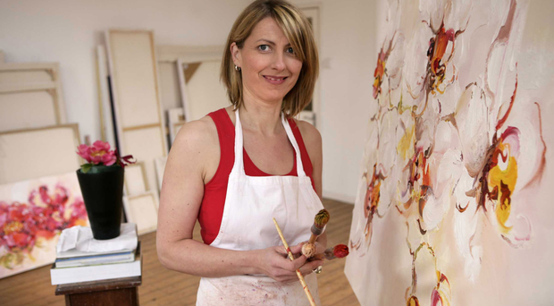 Nicola Russell working on one of her paintings
