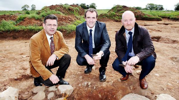 Dr John O'Keeffe, Mark H Durkan and Tony McCance at Tullaghoge in Cookstown, Co Tyrone, where the foundations of a house thought to belong to the Gaelic O'Hagan clan have been uncovered (Andrew Paton/Presseye/PA)