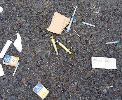 Discarded syringes and assorted items used by addicts found by Julie