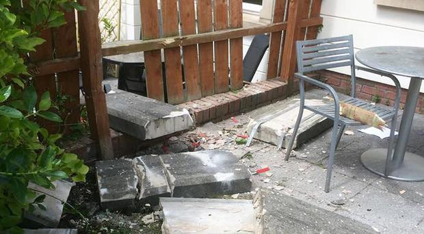 The masonry that fell into Dr Ramy Waly's back garden in Annadale, where his family had been relaxing just minutes before