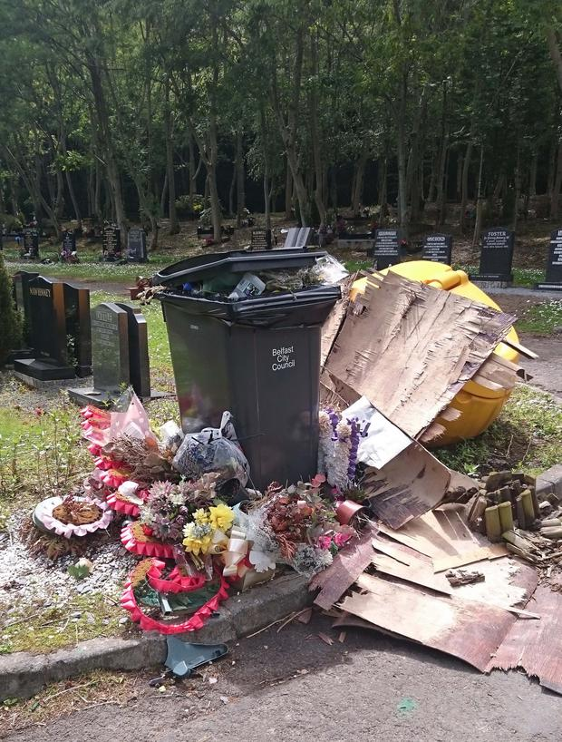 The overflowing bin and rubbish at Roselawn, just feet from headstones