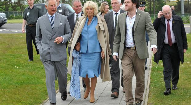 Prince Charles and the Duchess of Cornwall with Padraig O'Tuama (right) on a visit to Corrymeela to mark the organistion's 50th anniversary