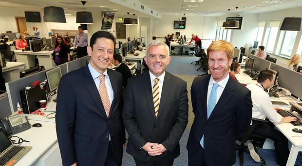 President of Diageo Europe John Kennedy, minister Jonathan Bell MLA and Diageo country director Jorge Lopes at the opening of Diageo Northern Ireland's new offices in Belfast city centre (Kelvin Boyes/Press Eye/PA)