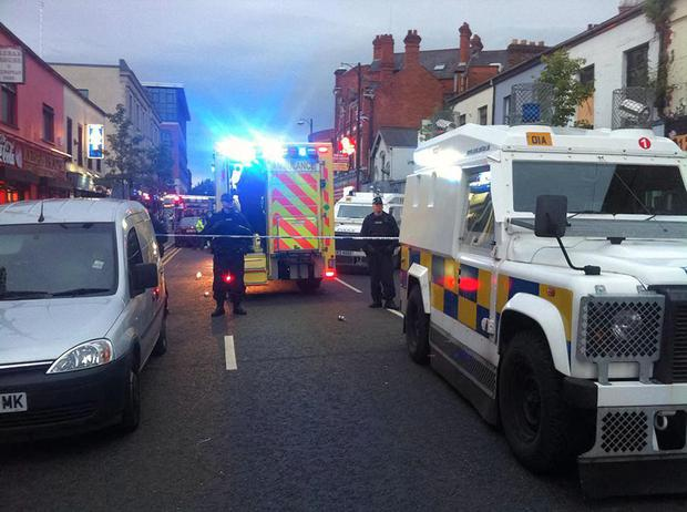 Heavily armed police and paramedics at the scene of the attack in the Sandy Row area of Belfast