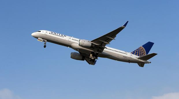 A United Airlines flight en route to Chicago landed at Belfast after a passenger became erratic and disruptive and demanded nuts