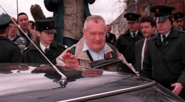Brendan Smyth is surrounded by RUC officers as he leaves Limavady Courthouse in 1997