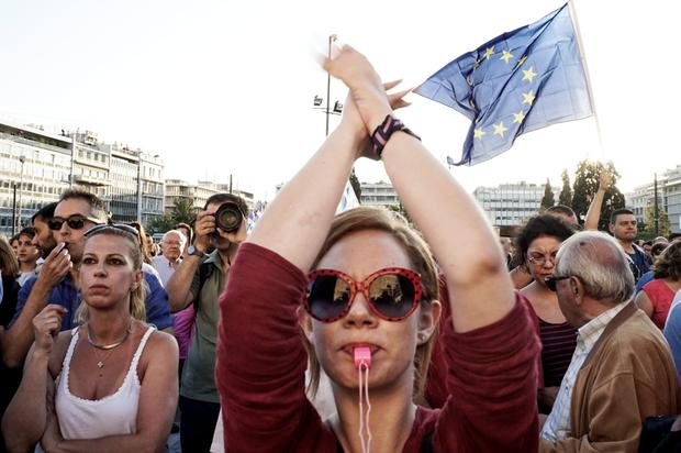 Thousands of pro-euro demonstrators gather during a rally outside the Greek parliament in Athens yesterday to show support for the country's future in the eurozone
