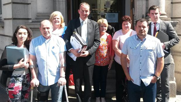 Members of the Fox family and their legal team outside Belfast Coroners' Court