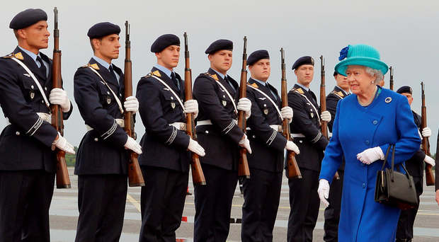The Queen inspects the Guard of Honour as she and Prince Philip arrive at Berlin Tegel airport for the start of her state visit to Germany yesterday