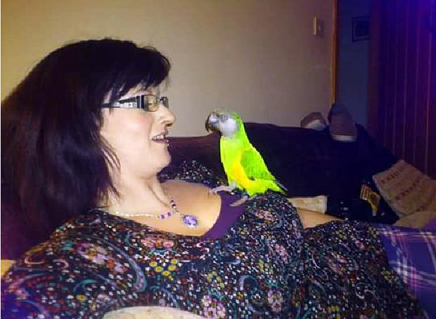 Ann Smith with her beloved parrot Zissou
