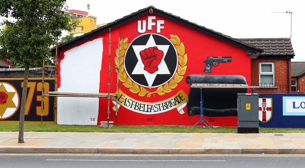 The mural being repainted at 'Freedom Corner' in east Belfast
