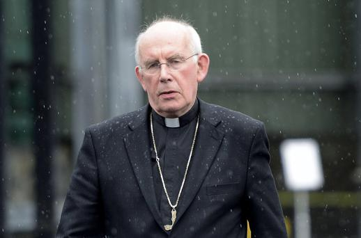 Cardinal Sean Brady leaves Banbridge Court yesterday after giving evidence in the Historical Institutional Abuse Inquiry